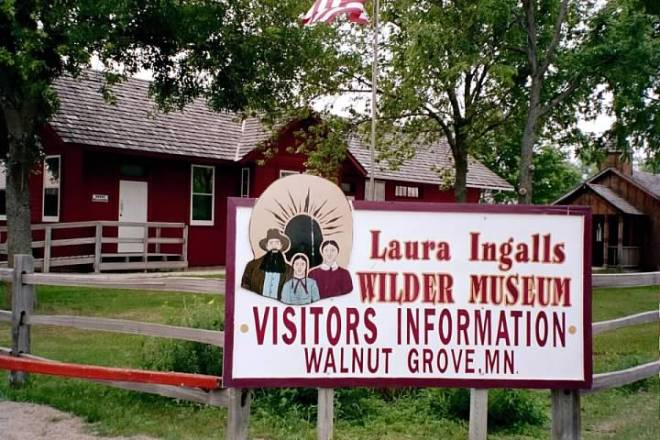 A sign in front of the red Depot museum.
