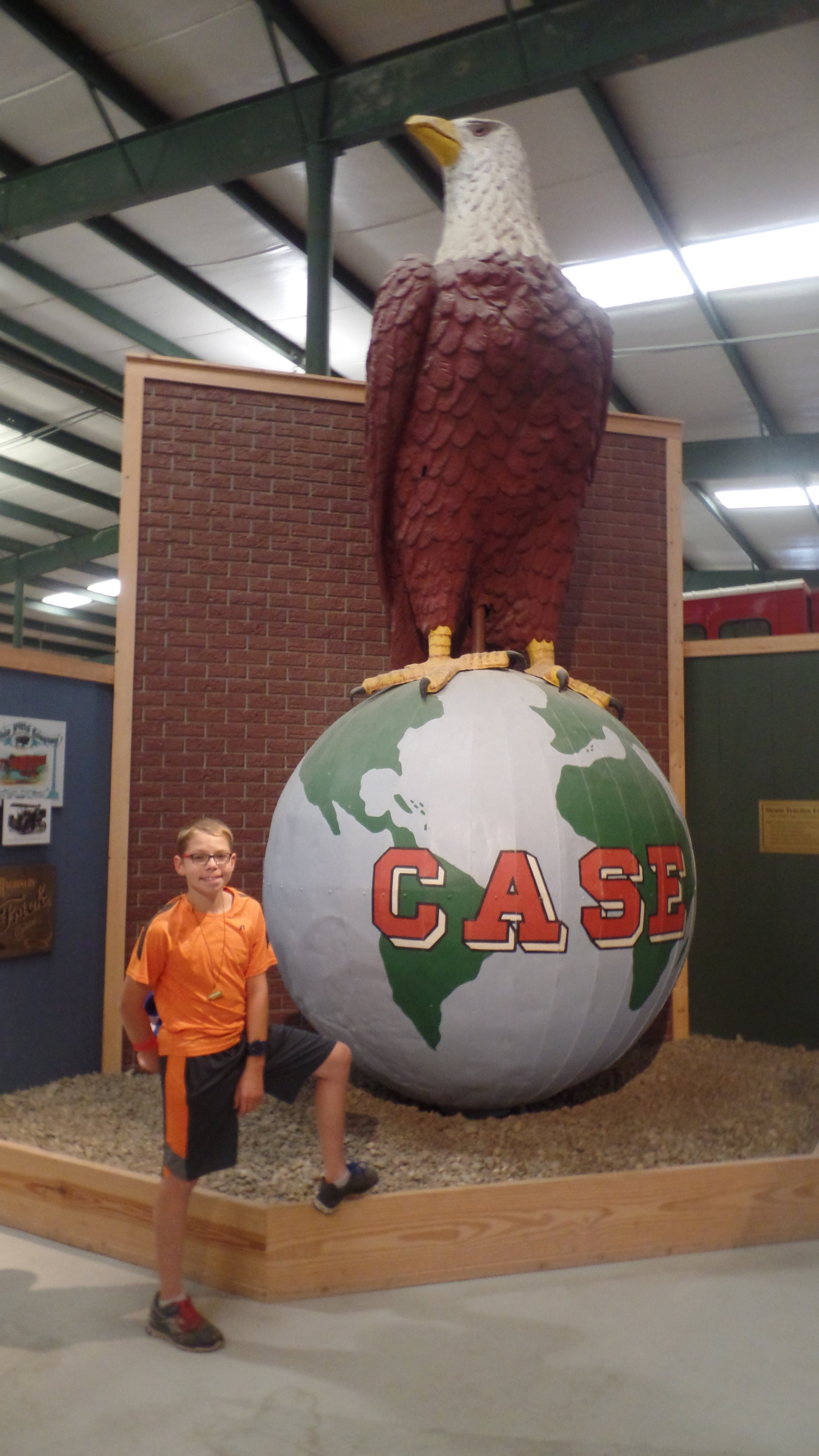A giant statue of the case symbol of the Case tractor, large eagle standing on a globe