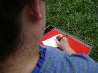 Laura Writing Close Up