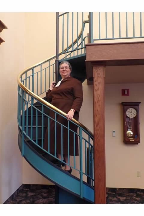 Sarah on library staircase