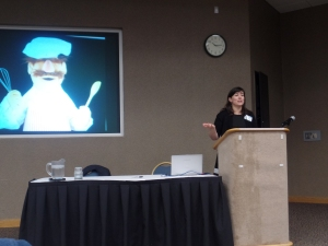 Susan Evans McClure of Smithsonian presenting in front of the Swedish Chef