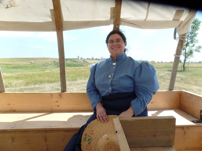 Sarah on Covered Wagon at Ingalls Homestead