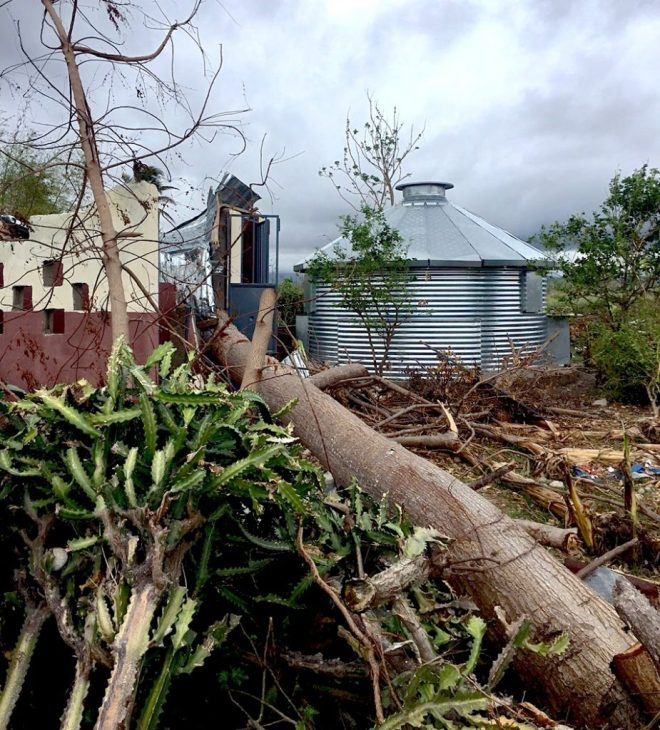 After Hurricane Matthew, a traditionally constructed home and a Safe-T-Home side by side, Photo courtesy of GoGlobal Serve