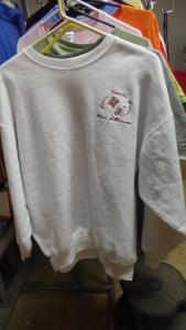 White sweatshirt hanging on a rack