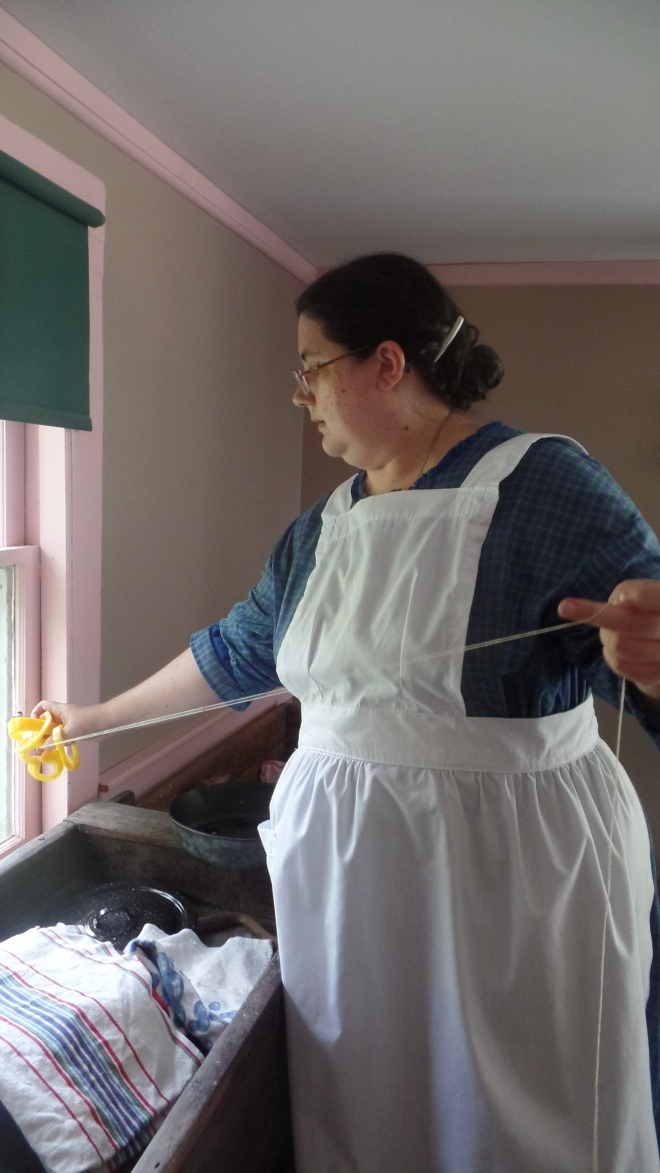 Woman in Apron Threading Pepper