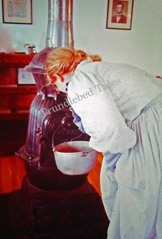 One-Room School Teacher Cooking Cocoa