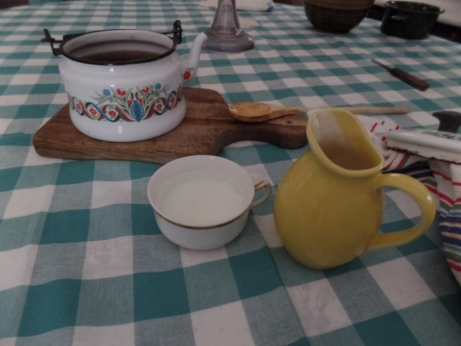 Brewed Tea in Pot, Water and Milk in Teacup