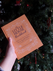 Cover of new edition of Little House Cookbook in front of a Xmas tree