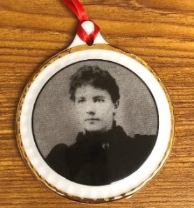 A photo of young Laura on a china ornament