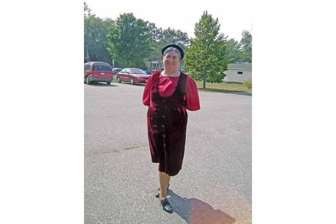 Sarah as old Laura wearing velvet dress