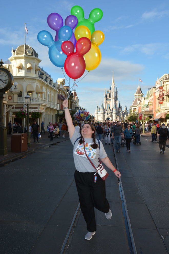 Sarah with Balloons on Main Street